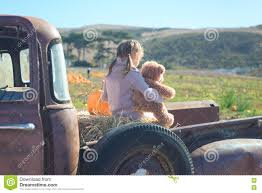 100 Best Old Truck Little Girl Hugging Her Teddy Bear Sitting In The At T