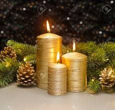 Pine Cone Christmas Tree Decorations by Three Golden Candles With Christmas Tree Branches And Pine Cones