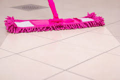 cleaning the tiled floor with purple mop stock image image 35070153