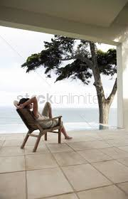 Woman Looking At Sea Sitting On Lounge Chair By Infinity ... Ethimo Finity Lounge Armchair Tattahome Infinity Chaise Lounge Mondo Contract Zero Gravity Chair Parts Buy Partsinfinity Chairzero Product On Alibacom Woman Looking At Sea Sitting Lounge Chair By Finity Design Exllence Design Caravan Sports Oversized Beige Metal Patio Review Ethimo Armchair I Casa Group Black 2pack Lc525im