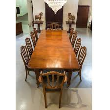 Hand Crafted Anglo Indian Or British Colonial Teakwood Extending Dining Table With Ten Chairs