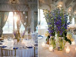 Branch centerpieces with mason jars and purple flowers