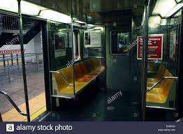New York City Subway train with open doors standing on a station