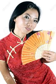 portrait of chinese charming looks holding small fan in