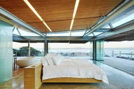 100 Modern Luxury Bedroom Luxury Bedroom Open To Patio With Ocean View Stock Photo