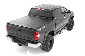 Soft Tri-Fold Bed Cover For 2014-2017 Toyota Tundra   Rough Country ... Rollbak Tonneau Cover Retractable Truck Bed Weathertech 8rc5246 Roll Up Toyota Tundra Black Covers Toyota 2014 Car Truxport Covertruxedo 272001 Truxport 2016 Bak Revolver X2 Hard Rollup 8rc5228 106 Northwest Accsories Portland Or 8rc5205 Retrax The Sturdy Stylish Way To Keep Your Gear Secure And Dry Diamondback Review Essential Gear Episode