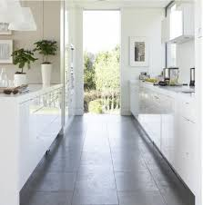 This Bright White Galley Style Kitchen Feels Large