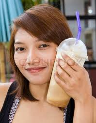 Happy Woman Drinking Iced Coffee