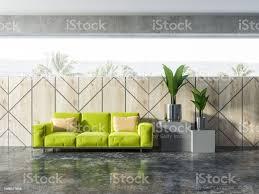 holz wand muster wohnzimmer grüne sofa pflanzen stockfoto und mehr bilder behaglich