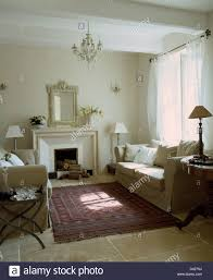 French Country Living Rooms Images by Cream Sofas On Either Side Of Fireplace In French Country Living
