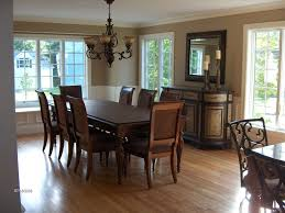 Impressive Sunroom Dining Design With Wood Chairs And Table Furniture Also Cozy Hardwood Flooring Ideas