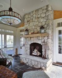 Rustic Living Room With Polished Stone Tile Floor Pendant Light Transom Window
