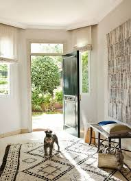Even A Wide Foyer Can Feel Cozy And Inviting With The Addition Of Handwoven Rug Interesting Artwork An Iron Bench Shapely Curved Legs