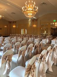 Wedding Chair Sash Buckles by Champagne Satin Sashes On Ivory Spandex Covers In The Congress