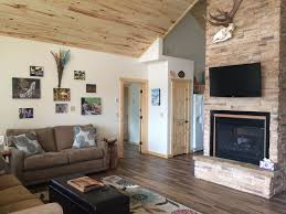 Living Room With Fireplace In The Middle by All New Construction Home Offers Heated Ga Vrbo