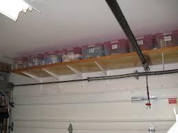 Ceiling Material For Garage by Garage Ceiling Storage Over Door Installing Garage Ceiling
