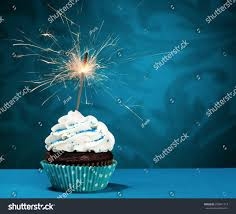 Birthday Cupcake with a sparkler over a blue background