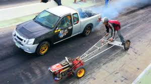 Kubota FARM TRACTOR Owned MITSUBISHI PICKUP TRUCK In Drag Racing ... Truck Drag Racing In Canada Involves Rolling Coal And 71 Tons Of Semi Trent Willson Radical Classic Chevy San Antonio Paramount Trucks Unbelievable Race Of Two 9second 2003 Dodge Ram Cummins Diesel Big Tire Gmc Customized S10 Body Style For Bkk Thailandjune 24 Isuzu Stock Photo Edit Now Amazing With Fully Loaded Trailers Fords Version The Farm Fordtrucks
