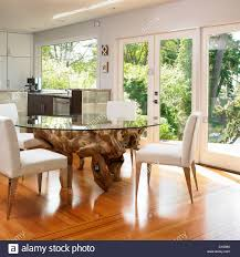 Glass Topped Dining Table With Large Tree Root Base Victoria Stock Vancouver Island British Columbia Contemporary Dinner Kitchen Height Chilton Furniture