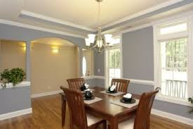Formal Dining Room With Arched Opening And Cut Outs To The Foyer Entrance