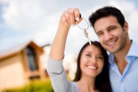 Couple Holding House Keys