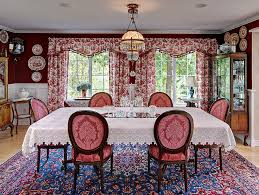 Floral Drapes And Beautiful Red Walls Bring The Victorian Dining Room Alive