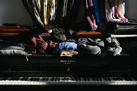 3840x2563 Clothes Folded And Thrown Atop A Piano In Studioclothes On The Keys 4k Wallpaper Background 3395