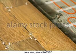 installation of heating elements in warm tile floor and