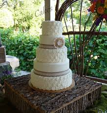 Rosettes And Burlap Rustic Buttercream Textured Brides Cake With Lace Ribbon