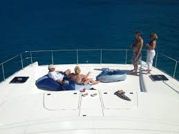 Nirvana Luxury Charter Power Catamaran Guests On Bean Bags