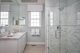 marble beveled subway tiles transitional bathroom