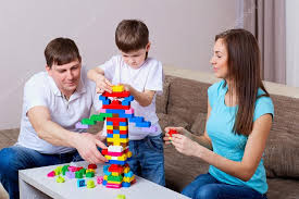 Family At The Table Playing Board Games Stock Photo