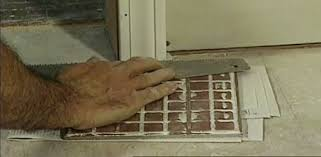 how to cut door jambs when laying a tile floor today s homeowner