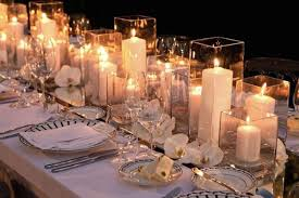 Tall Candle Votives White ROses And Mirrored Stands For Reception