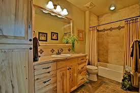 rustic bathroom with raised panel ceramic tile in hayden