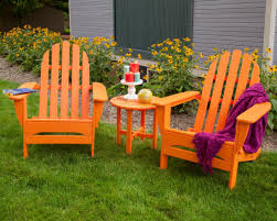 The History Of The Adirondack Chair | HGTV Trex Outdoor Fniture Hd Classic White Patio Adirondack Welcome To Dfohecom Pawleys Island Hammocks Maxim Childs Chair Kids Wood For Backyard Lawn Deck Cod And Ftstool Set By Chair Wikipedia Around The Firepit Hayneedle Has These Row Of Colorful Recycled Plastic Resin Color Chairs Colorful Chairs Looking Out At View Stock Photo Cape 18 Free Plans You Can Diy Today