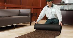 UniFirst Employee Rolls Out Clean Floor Mat