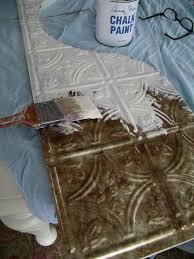 paint faux tin tiles use as backsplash also as kickplate