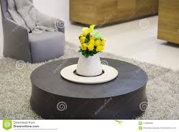100 Living Room Table Modern Round Wooden Coffee In The With A Vase Of Flowers