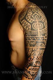 Man With Tribal Tattoo On Left Sleeve