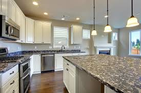 White Cabinets Dark Countertop Backsplash by Stainless Steel Knobs Diamond Shape White Cabinets With Black