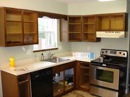 Cabinet Refinishing Kit Before And After by Techniques In Creating Refinished Kitchen Cabinets Before And