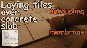 laying tiles on concrete slab with an uncoupling membrane