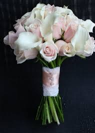 roses and calla lilies wedding bouquet lace handle details on