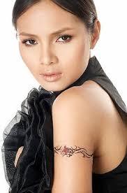 Beautiful Girl With Armband Tattoo On Biceps