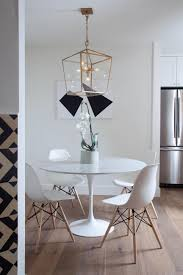 White Eames-style Dining Chairs Surround The Contemporary Round ... Round Back Ding Chair Stunning High Upholstered Magnussen Home Walton Wood Table Set With Roundup Natural Linen Paige Chairs Of 2 World Market Signature Design By Ashley Trudell 5piece Gray Roundback Eichholtz Dearborn 1 Oroa Cramco Inc Contemporary Parkwood With Amazoncom Formal Luxurious 5pc Antique Silver Finish Turner At Gardnerwhite Davenport And 4 In Ivory Oak Dav010 Beige Ding Chair Curve Arm Black Wood Frame Also Round