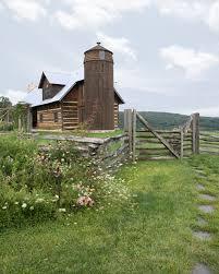 A Beautiful Farmhouse With Silo Framed By Rustic Split Rail Fence Wealth