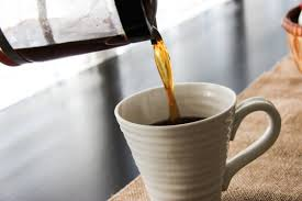 Coffee Pot Pouring Into Mug