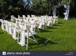 Arch For Wedding Ceremony. White Decorated Chairs On A Green Lawn ... 40 Pretty Ways To Decorate Your Wedding Chairs Martha Stewart Weddings San Diego Party Rentals Platinum Event Monogram Decorations Ideas Inside Tables And 1888builders Spandex Folding Chair Cover Lavender Padded Hire For Outdoor Parties In Sydney Can Plastic Look Elegant For My Ctc 23 Decoration White Galleryeptune Aisle Metal Unique Reception Seating