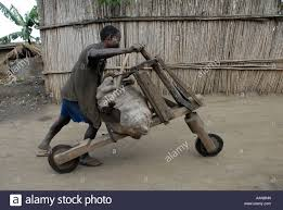 Man With Chukudu Homemade Wooden Scooter In North Kivu Province The Eastern Democratic Republic Of Congo